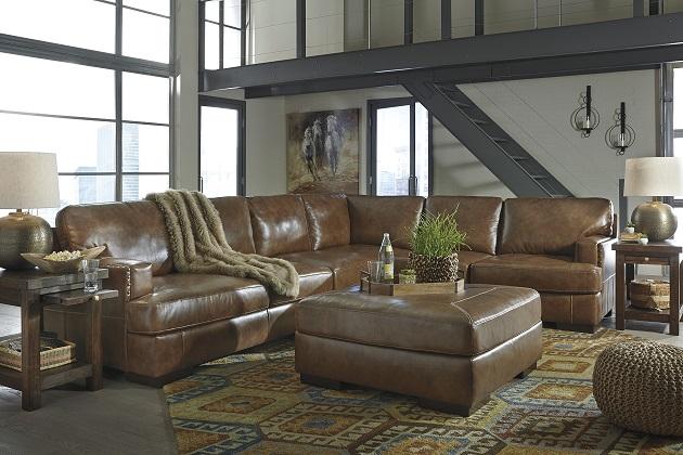 Signature Design #304 Top Grain Leather Sectional As Shown 3 Piece Sale  Price $2249. Square Top Grain Leather Ottoman $399